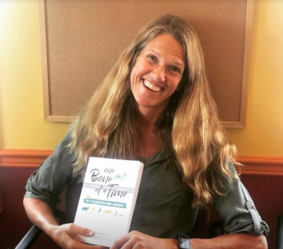 Dr. Alison Seely with her book One Bone at a Time
